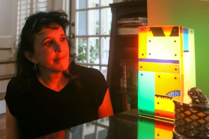 Suzie Barrows, a longtime member of the McNay Contemporary Collectors Forum, with an acrylic light box by Ron Copeland that she purchased during a forum visit to Pittsburgh. The forum is made up of art lovers who raise funds to purchase contemporary pieces for the McNay Art Museum, while also learning more about contemporary art and, no small thing, expanding their own collections.