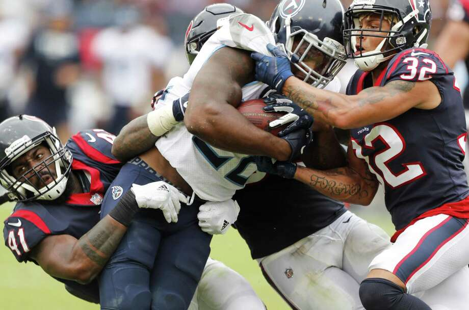 Tennessee Titans running back Derrick Henry (22) is stopped by Houston Texans linebacker Zach Cunningham (41) and defensive back Tyrann Mathieu (32) during the fourth quarter of an NFL football game at Nissan Stadium on Sunday, Sept. 16, 2018, in Nashville. Photo: Brett Coomer, Houston Chronicle / Staff Photographer / © 2018 Houston Chronicle