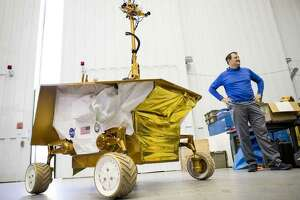 Bill Bluethmann, a robotics enginer at Johnson Space Center, talks about at the Resource Prospector 2015 Rover Prototype at the space center in this November 2017 file photo.