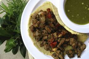 Carne asada taco on a handmade corn tortilla with jalapeño verde salsa from Luz Mia Restaurante.