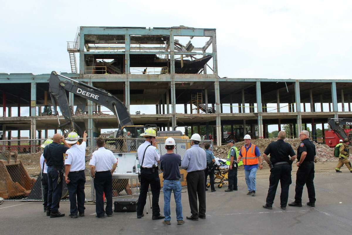 Public safety personnel observe the roof collapse that injured two construction workers at 860 Canal Street in Stamford on Monday, Sept. 17.