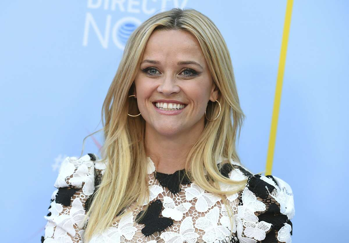 """FILE - In this Aug. 6, 2018 file photo, Reese Witherspoon arrives at the Hello Sunshine Video on Demand channel launch in Los Angeles. Witherspoon's Hello Sunshine and WME Partner announced Tuesday, Sept. 11, that """"Together Live,"""" a ten-city North America tour bringing together women of all ages and backgrounds will launch in Boston on Nov. 3. Leaders, musicians, comedians, celebrities and ordinary people will share real stories from their lives. (Photo by Jordan Strauss/Invision/AP, File)"""