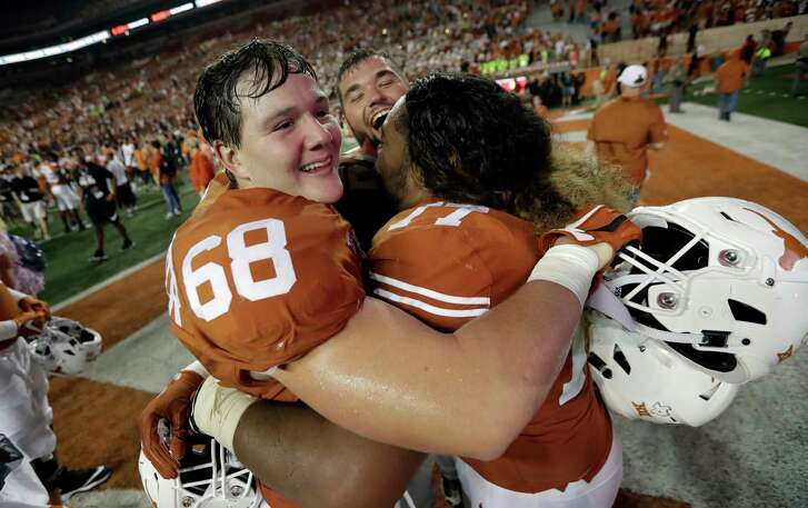 Texas offensive lineman Derek Kerstetter (68) celebrates with teammates Patrick Vahe (77) and Samuel Cosmi, center, after their win over USC in an NCAA college football game, Saturday, Sept. 15, 2018, in Austin, Texas. (AP Photo/Eric Gay)