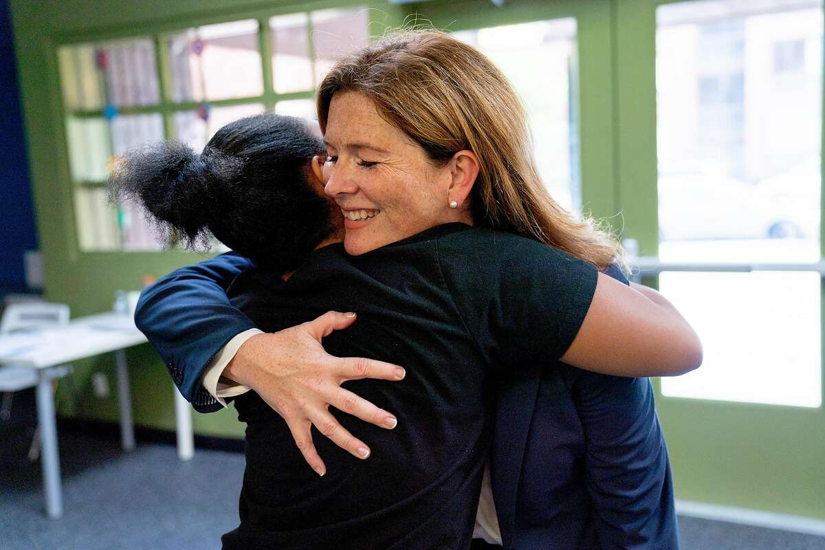 From right: Suzy Loftus and Morgan Tucker hug after meeting during the Community Safety Initiative program at the Ella Hill Hutch Community Center, Friday, Sept. 14, 2018, in San Francisco, Calif.