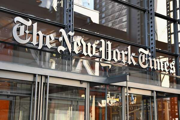 """The New York Times building is seen on September 6, 2018 in New York. - A furious Donald Trump called September 5, 2018 for the unmasking of an anonymous senior official who wrote in the New York Times that top members of his administration were undermining the president to curb his """"misguided impulses."""" Trump asked if the unsigned op-ed could be considered treasonous, assailed the newspaper for the """"gutless"""" piece and questioned whether the senior official it was attributed to actually existed. """"TREASON?"""" Trump posted in response to the article entitled """"I Am Part of the Resistance Inside the Trump Administration,"""" which claimed the president's own staff see him as a danger to the nation.""""Does the so-called 'Senior Administration Official' really exist, or is (Photo by ANGELA WEISS / AFP)ANGELA WEISS/AFP/Getty Images"""