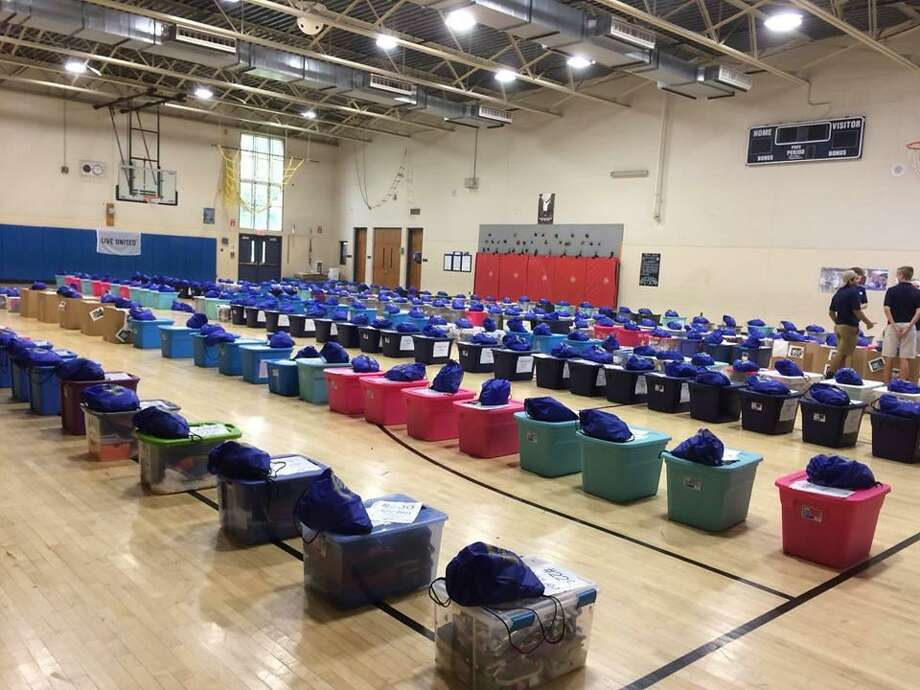 Valley United Way's Corporate Volunteer Council recently presented 253 students from Mead and Prendergast schools with bins packed with new clothes and school supplies. Photo: Contributed Photo / Ansonia Public Schools