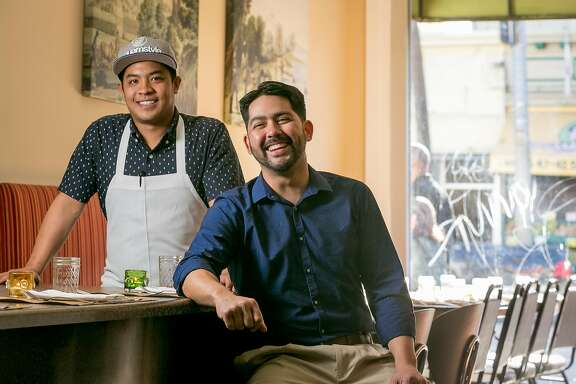 Chef/owner Shawn Naputi (apron) and his biz partner Shawn Camacho at Prubechu in San Francisco, Calif., are seen on Saturday, April 5th, 2014.