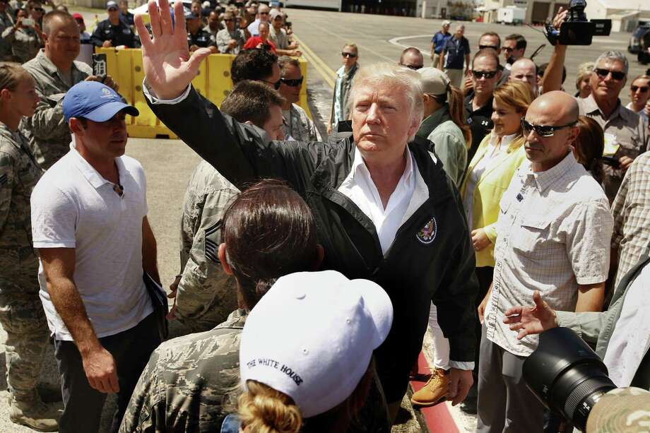 President Donald Trump arrives at Muniz Air National Guard Base in Carolina, Puerto Rico, on Oct. 3, 2017, almost two weeks after Hurricane Maria hit the island. Last week, the president cast doubt on revised estimate of deaths due to the storm, calling it a Democratic plot to make him look bad. Photo: Carolyn Cole /TNS / Los Angeles Times
