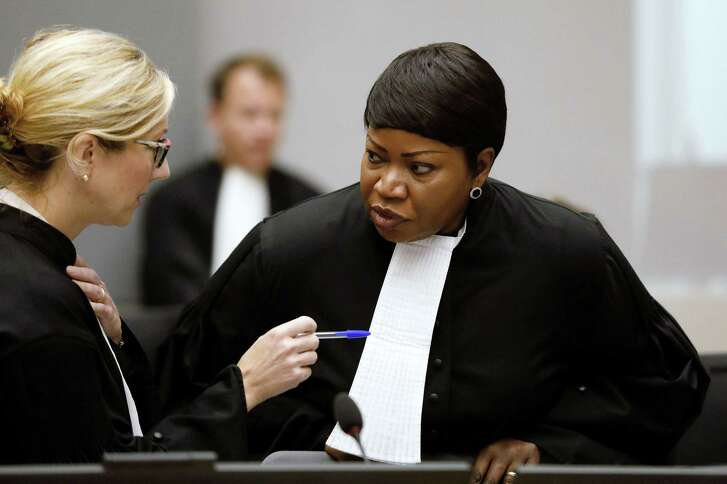 International Criminal Court (ICC) chief prosecutor Fatou Bensouda, right, speaks with a colleague at the courtroom of the court during the closing statements of the trial of former Congolese warlord Bosco Ntaganda in the Hague, the Netherlands, on August 28. Bensouda has indicated she will seek charges against the U.S. for its conduct in Afghanistan.