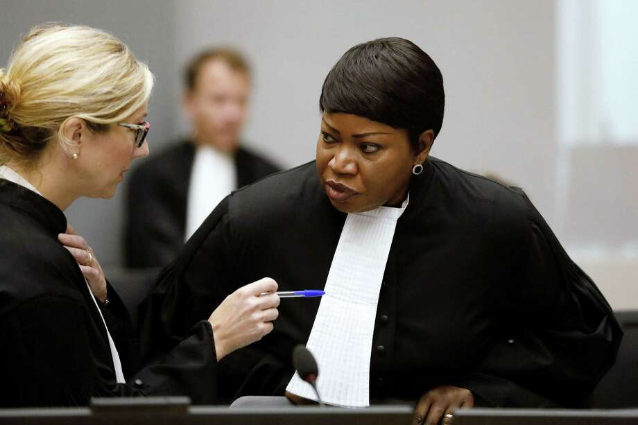 International Criminal Court (ICC) chief prosecutor Fatou Bensouda, right, speaks with a colleague at the courtroom of the court during the closing statements of the trial of former Congolese warlord Bosco Ntaganda in the Hague, the Netherlands, on August 28. Bensouda has indicated she will seek charges against the U.S. for its conduct in Afghanistan. Photo: BAS CZERWINSKI /AFP /Getty Images / AFP