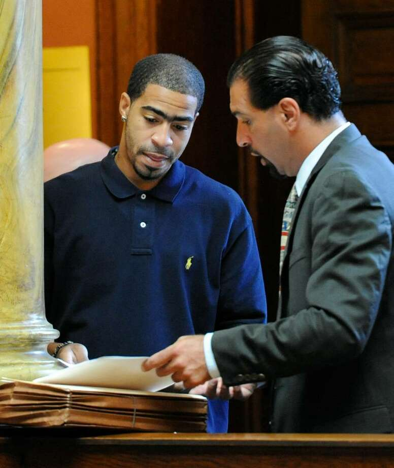 One-time basketball star Tiki Mayben, left, speaks with his lawyer, Greg Cholakis, Tuesday before entering the courtroom at  the Rensselaer County Courthouse to be sentenced for cocaine dealing.  (Skip Dickstein / Times Union) Photo: Skip Dickstein / 2008