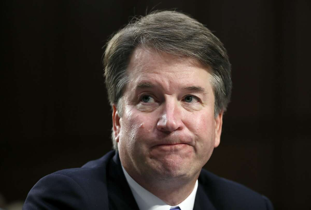 In this Sept. 6, 2018 photo, Supreme Court nominee Brett Kavanaugh reacts as he testifies after questioning before the Senate Judiciary Committee on Capitol Hill in Washington. Official Washington is scrambling Monday to assess and manage Kavanaugh's prospects after his accuser, Christine Blasey Ford, revealed her identity to The Washington Post and described an encounter she believes was attempted rape. Kavanaugh reported to the White House amid the upheaval, but there was no immediate word on why or whether he had been summoned.