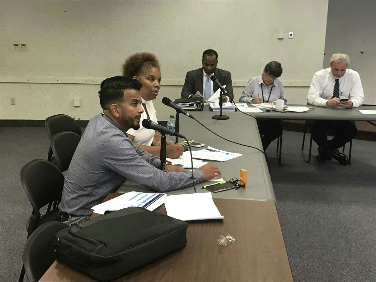 Board of Education Finance Committee members Jamell Cotto and Tamiko Jackson-McArthur.