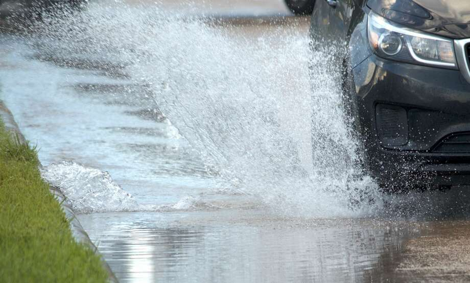 Water flows from a broken water line along Weslayan Street just north of Bissonnet Street on Monday, Sept. 17, 2018. Photo: Jay R. Jordan