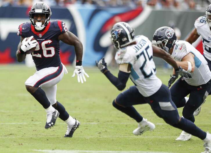 Houston Texans running back Lamar Miller (26) is chased down by Tennessee Titans cornerback Adoree' Jackson (25) as he runs around the end during the third quarter of an NFL football game at Nissan Stadium on Sunday, Sept. 16, 2018, in Nashville.