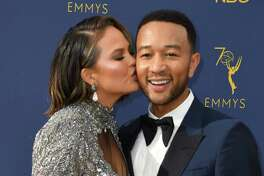 Lead actor in a limited series or movie nominee John Legend and his wife model Chrissy Teigen arrive for the 70th Emmy Awards at the Microsoft Theatre in Los Angeles, California on September 17, 2018. (Photo by VALERIE MACON / AFP)VALERIE MACON/AFP/Getty Images