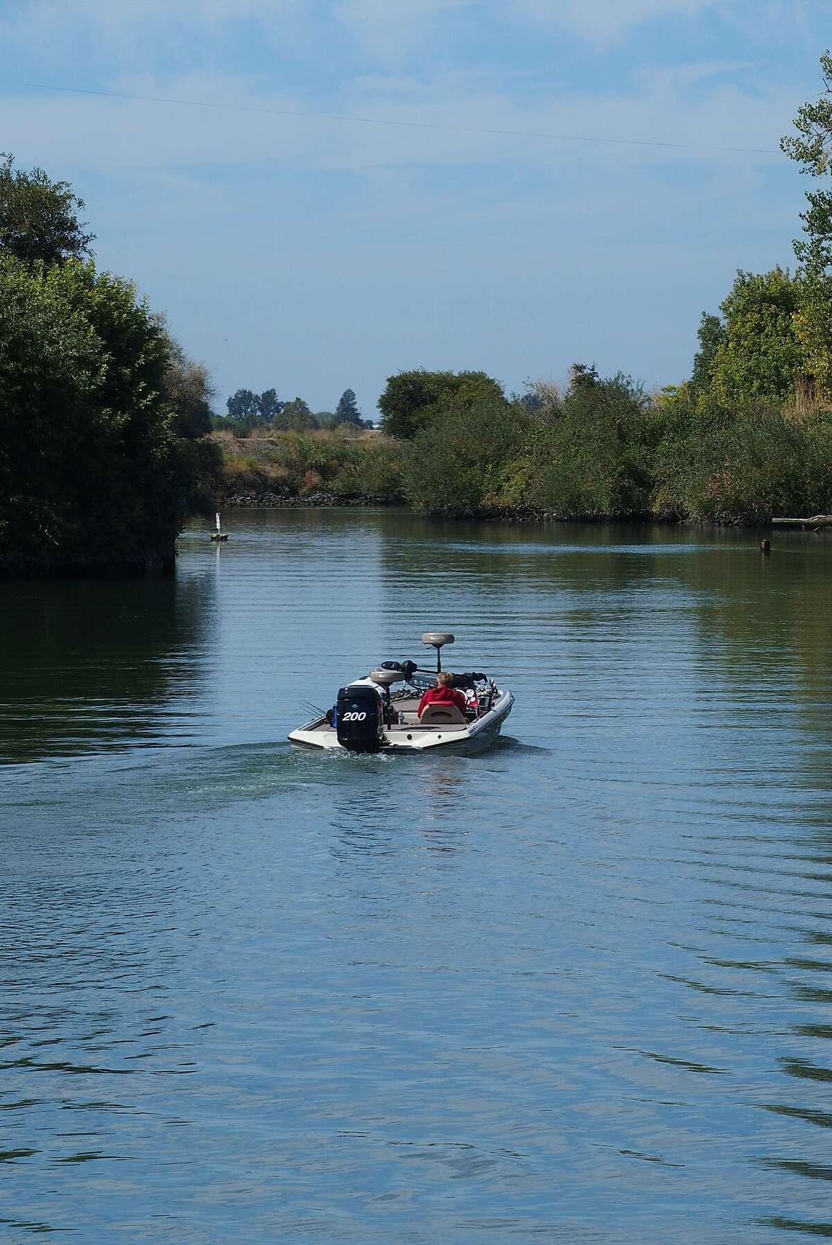 Boaters sail up the S. Mokelumne River near Walnut Grove.