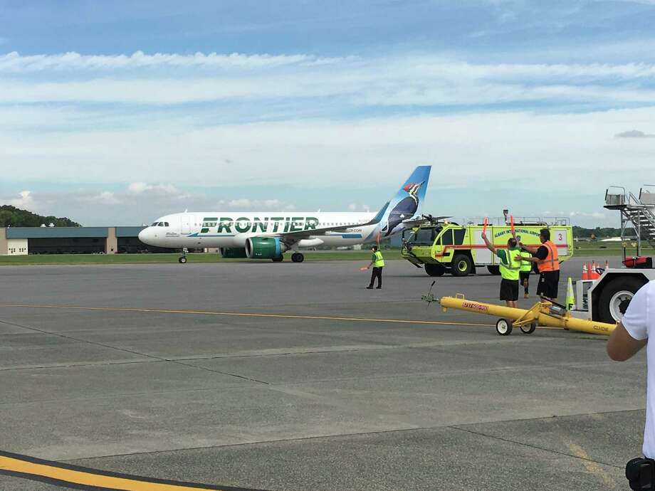 Frontier Airlines' first flight to Albany lands Monday morning, Sept. 17, 2018, at Albany International Airport. Airport fire trucks greeted the plane by spraying a traditional arc of water over the Airbus A321neo as it made its way to the gate. Photo: Eric Anderson/Times Union