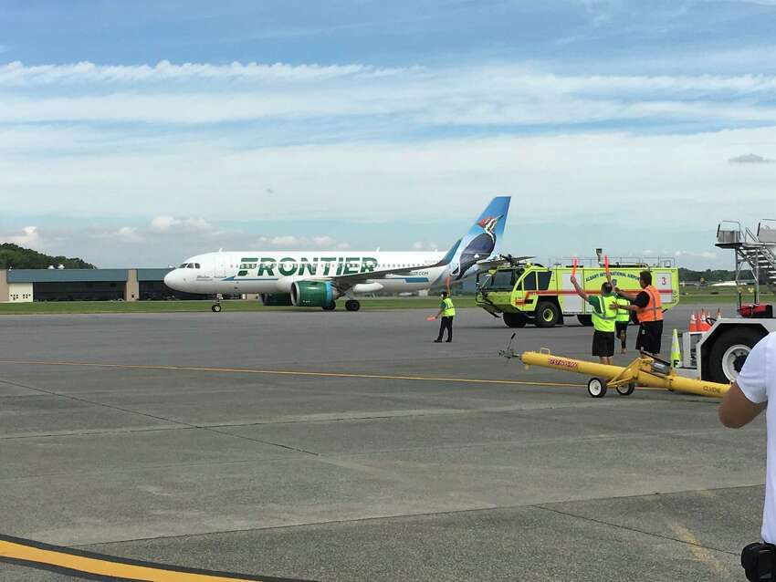 Frontier Airlines' first flight to Albany lands Monday morning, Sept. 17, 2018, at Albany International Airport. Airport fire trucks greeted the plane by spraying a traditional arc of water over the Airbus A321neo as it made its way to the gate.