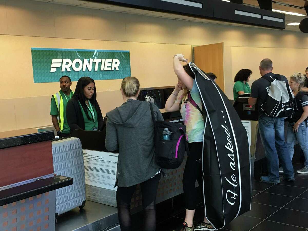 Passengers check in Monday morning for Frontier Airlines' first flight from Albany to Denver. The ultra-low fare carrier will offer flights to Denver on Mondays and Fridays.