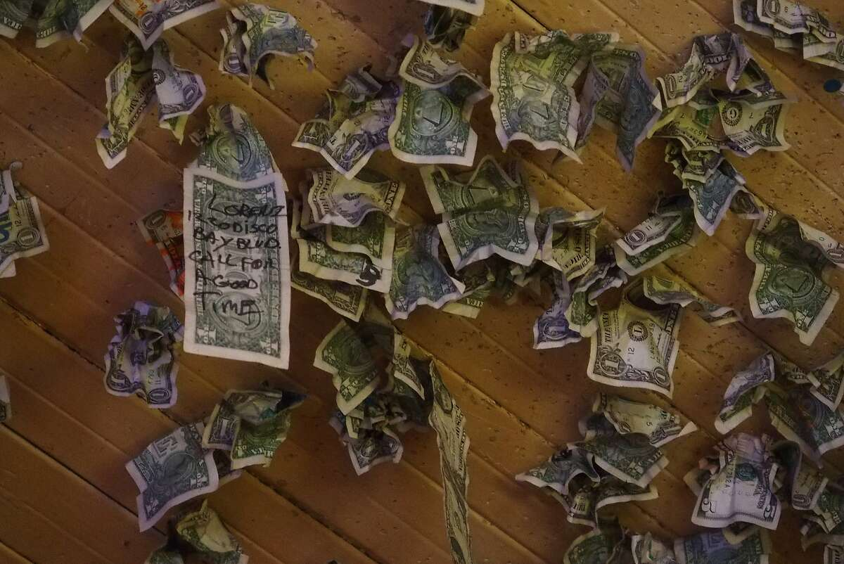 Dollar bills stuck to the ceiling at Al's Place (also known as Al the Wop's) in the historical Chinese town of Locke.