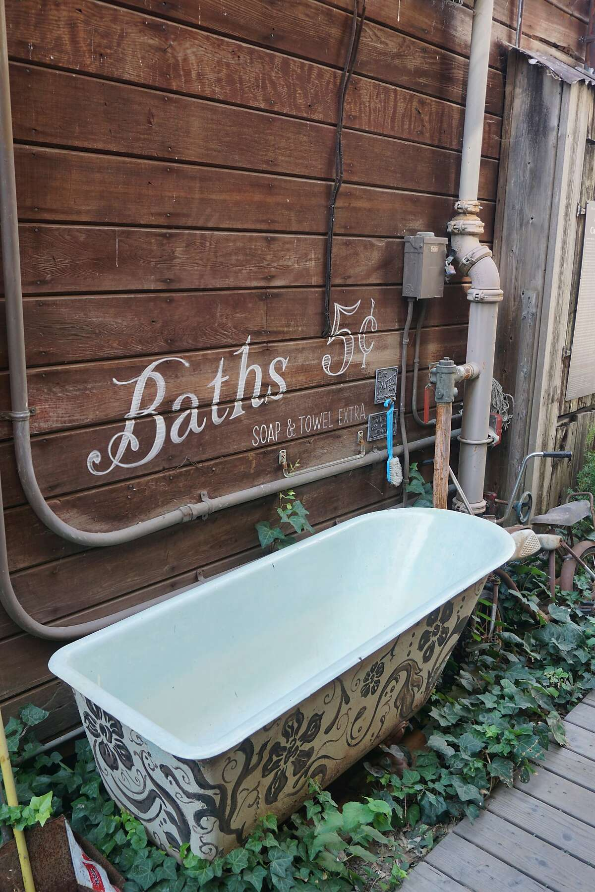 A decorated bathtub on an alley in the historical Chinese enclave of Locke near Walnut Grove.