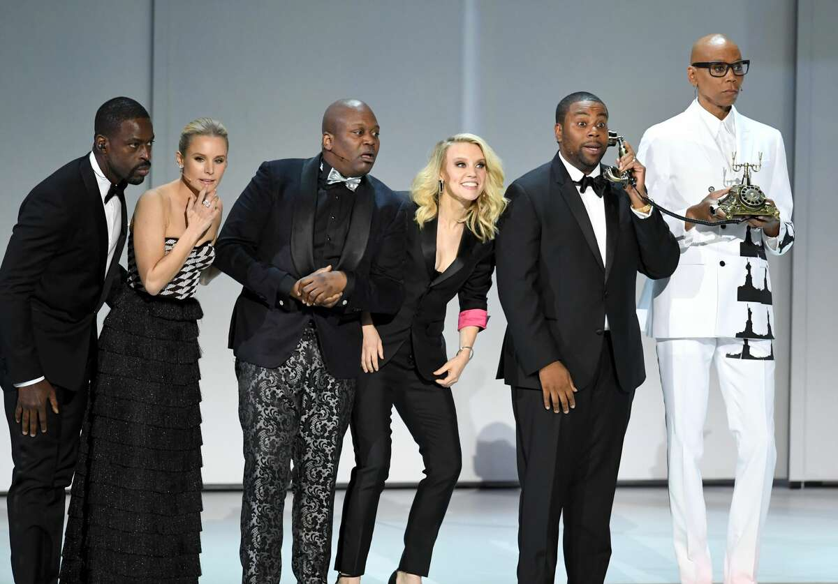 Sterling K. Brown, Kristen Bell, Tituss Burgess, Kate McKinnon, Kenan Thompson, and RuPaul perform onstage during the opening intro of the 70th Emmy Awards. The ensemble performed a satirical song about the presence of racism and sexism in Hollywood, proclaiming that