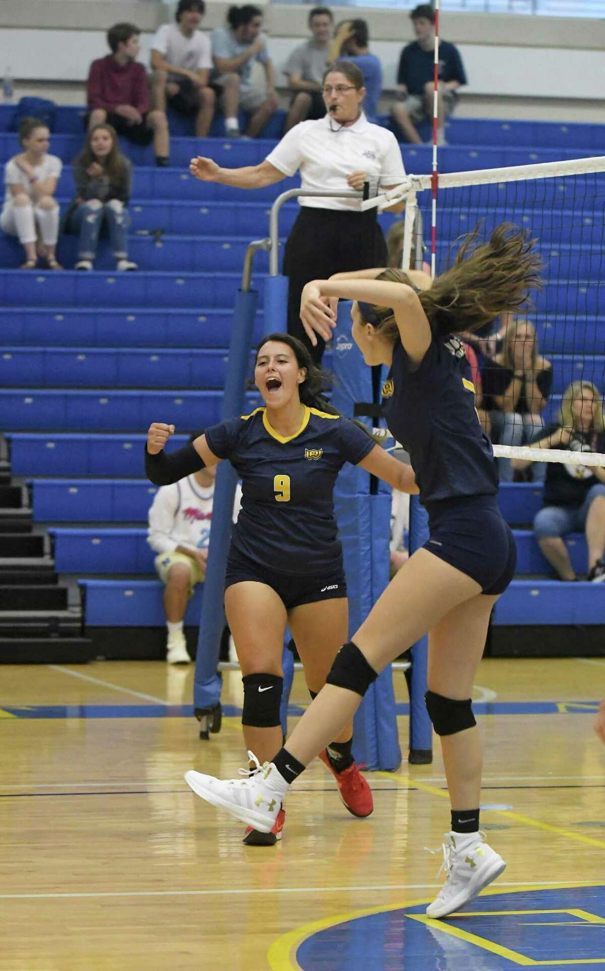 Woodstock Academy?'s Paula Hernandez, left, and Marissa Mayhew celebrate during the Woodstock Academy at Newtown High School girls volleyball game, Sept. 17, 2018.