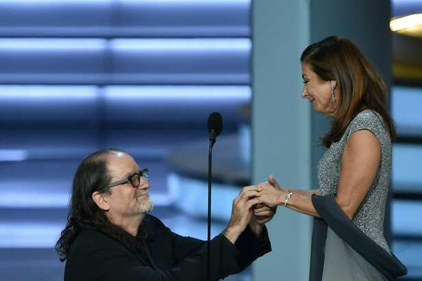 Glenn Weiss (L), winner of the Outstanding Directing for a Variety Special award for 'The Oscars,' proposes marriage to Jan Svendsen onstage during the 70th Emmy Awards at the Microsoft Theatre in Los Angeles, California on September 17, 2018. (Photo by Robyn BECK / AFP) (Photo credit should read ROBYN BECK/AFP/Getty Images)