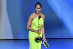 LOS ANGELES, CA - SEPTEMBER 17:  Regina King accepts the award for Outstanding Lead Actress in a Limited Series or Movie onstage during the 70th Emmy Awards at Microsoft Theater on September 17, 2018 in Los Angeles, California.  (Photo by Lester Cohen/WireImage)