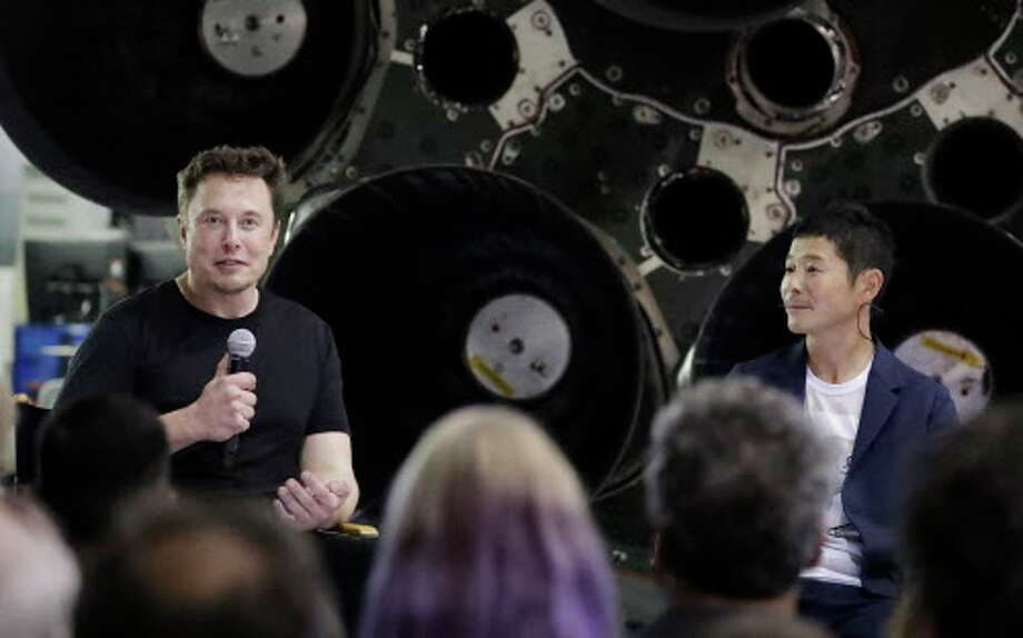 SpaceX founder and chief executive Elon Musk, left, announces Japanese billionaire Yusaku Maezawa, right, as the first private passenger on a trip around the moon, Monday, Sept. 17, 2018, in Hawthorne, Calif.  Photo: Chris Carlson, Associated Press / Copyright 2018 The Associated Press. All rights reserved