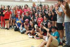 Beaverton's volleyball team and its fans pose with the Cedar River Cup after beating crosscounty rival Gladwin on Monday.