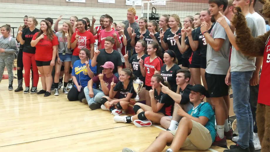 Beaverton's volleyball team and its fans pose with the Cedar River Cup after beating crosscounty rival Gladwin on Monday. Photo: Fred Kelly/fred.kelly@mdn.net