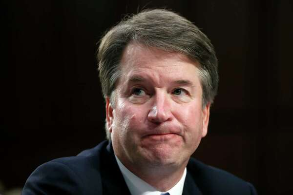 In this Sept. 6, 2018 photo, Supreme Court nominee Brett Kavanaugh reacts as he testifies after questioning before the Senate Judiciary Committee on Capitol Hill in Washington. Official Washington is scrambling Monday to assess and manage Kavanaugh?'s prospects after his accuser, Christine Blasey Ford, revealed her identity to The Washington Post and described an encounter she believes was attempted rape. Kavanaugh reported to the White House amid the upheaval, but there was no immediate word on why or whether he had been summoned. (AP Photo/Alex Brandon)