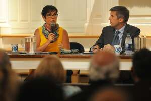 Republican Pam Staneski, left, and Democrat James Maroney, candidates for 14th District state senator, square off in a debate at the First United Church of Christ in Milford on Monday.