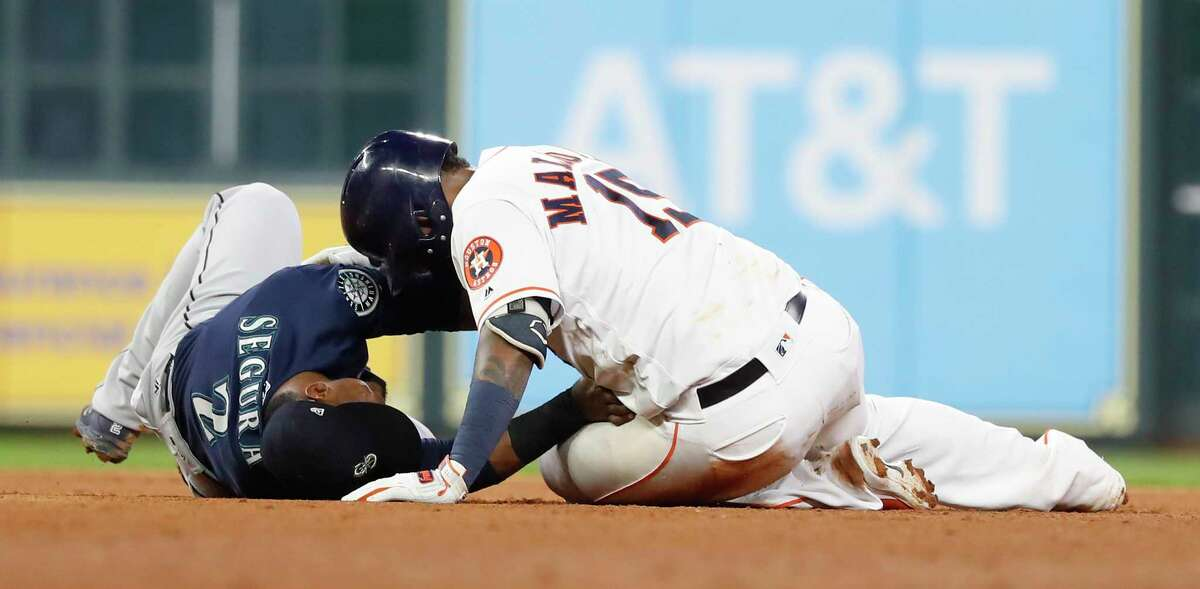 Seattle Mariners Jean Segura (2) tags Houston Astros Martin Maldonado (15) at second base as he tried to stretch a single into a double during the fifth inning of an MLB game at Minute Maid Park, Monday, September 17, 2018, in Houston.