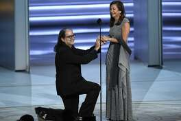 Glenn Weiss , left, proposes to Jan Svendsen at the 70th Primetime Emmy Awards on Monday, Sept. 17, 2018, at the Microsoft Theater in Los Angeles. (Photo by Chris Pizzello/Invision/AP)