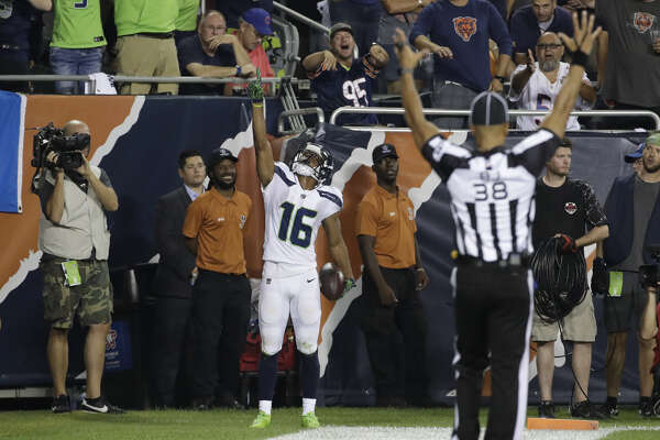 Seattle Seahawks wide receiver Tyler Lockett (16) celebrates a touchdown against the Chicago Bears during the second half of an NFL football game Monday, Sept. 17, 2018, in Chicago.