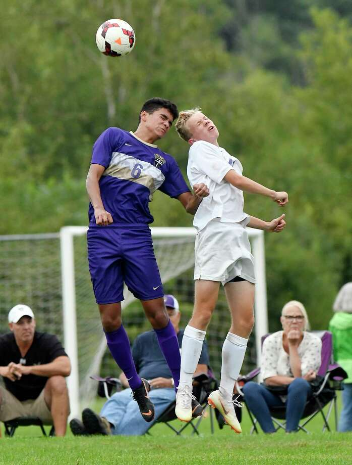 Christian Brothers Academy Dom Jones (6) and Ballston Spa's Liam O'Connell (41) battle for the ball during a Section II boys' soccer game Tuesday, Sept. 11, 2018, in Colonie, N.Y. (Hans Pennink / Special to the Times Union) Photo: Hans Pennink / Hans Pennink
