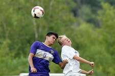 Christian Brothers Academy Dom Jones (6) and Ballston Spa's Liam O'Connell (41) battle for the ball during a Section II boys' soccer game Tuesday, Sept. 11, 2018, in Colonie, N.Y. (Hans Pennink / Special to the Times Union)