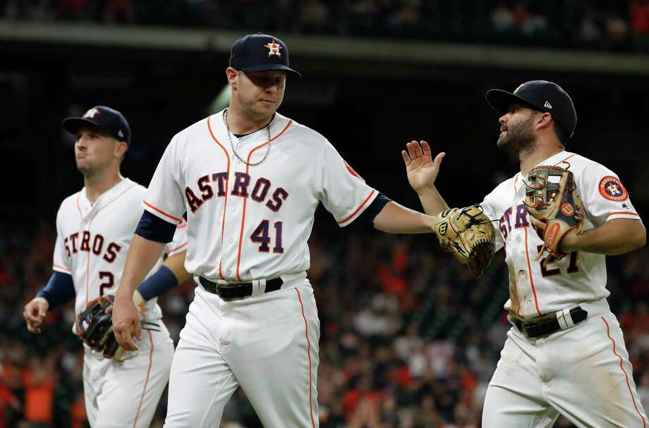 Houston Astros relief pitcher Brad Peacock (41) celebrates getting out of the ninth inning after Seattle Mariners Robinson Cano grounded out to Altuve during the ninth inning of an MLB game at Minute Maid Park, Monday, September 17, 2018, in Houston. Photo: Karen Warren, Staff Photographer / © 2018 Houston Chronicle