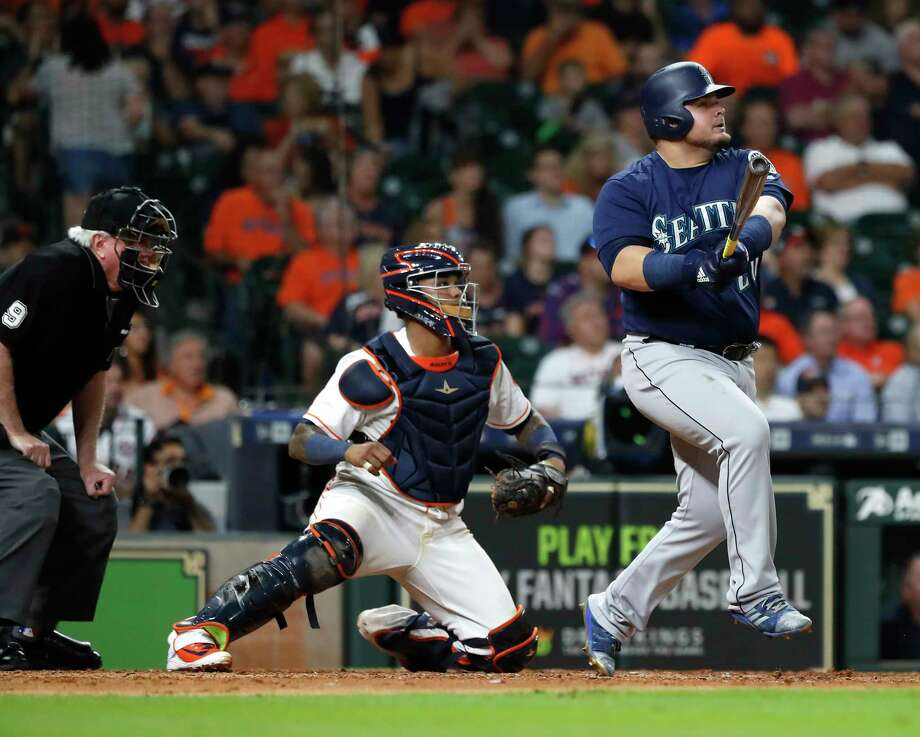 Seattle Mariners Daniel Vogelbach (20) hits a grand slam off of Houston Astros relief pitcher Hector Rondon during the eighth inning of an MLB game at Minute Maid Park, Monday, September 17, 2018, in Houston. Photo: Karen Warren, Staff Photographer / © 2018 Houston Chronicle