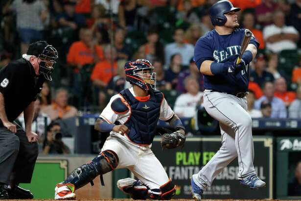 Seattle Mariners Daniel Vogelbach (20) hits a grand slam off of Houston Astros relief pitcher Hector Rondon during the eighth inning of an MLB game at Minute Maid Park, Monday, September 17, 2018, in Houston.