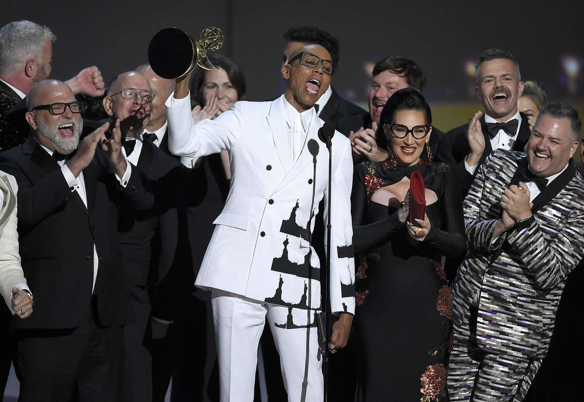 """RuPaul Charles, center, and the team from """"RuPaul's Drag Race"""" accept the award for outstanding reality/competition program at the 70th Primetime Emmy Awards on Monday, Sept. 17, 2018, at the Microsoft Theater in Los Angeles. (Photo by Chris Pizzello/Invision/AP)"""