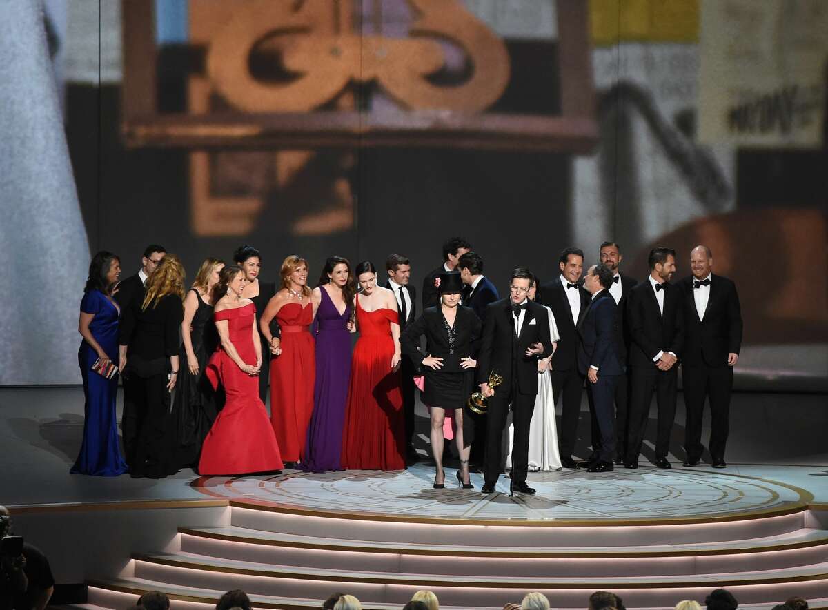 LOS ANGELES, CA - SEPTEMBER 17: Amy Sherman-Palladino (front center L) and Daniel Palladino (front center R) and cast and crew accept the Outstanding Comedy Series award for 'The Marvelous Mrs. Maisel' onstage during the 70th Emmy Awards at Microsoft Theater on September 17, 2018 in Los Angeles, California. (Photo by Kevin Winter/Getty Images)