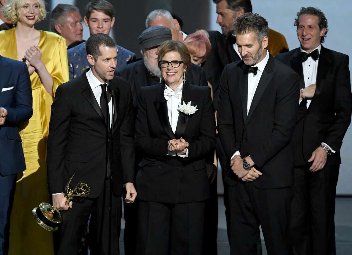 LOS ANGELES, CA - SEPTEMBER 17: (L-R) D. B. Weiss, Bernadette Caulfield, and David Benioff accept the Outstanding Drama Series award for 'Game of Thrones ' onstage during the 70th Emmy Awards at Microsoft Theater on September 17, 2018 in Los Angeles, California. (Photo by Kevin Winter/Getty Images)
