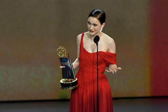 """Rachel Brosnahan accepts the outstanding lead actress in a comedy series award for """"The Marvelous Mrs. Maisel"""" onstage during the 70th Emmy Awards."""