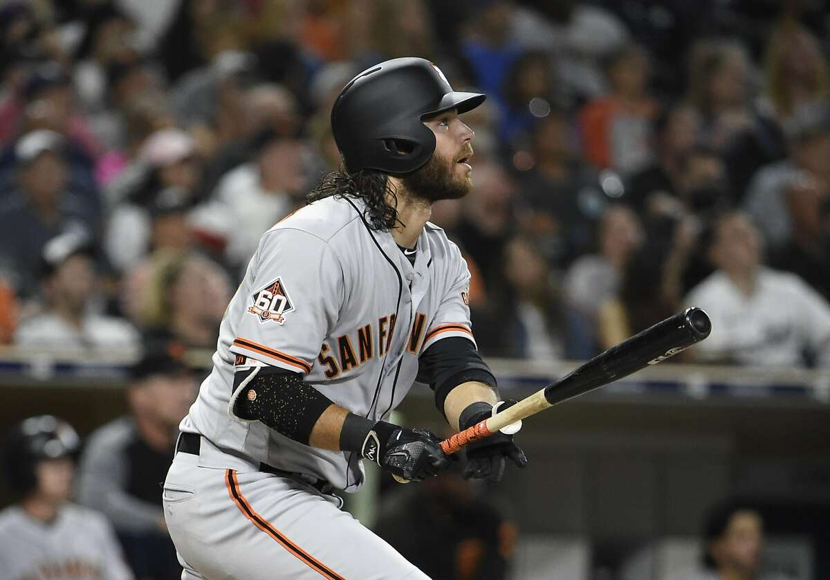 SAN DIEGO, CA - SEPTEMBER 17: Brandon Crawford #35 of the San Francisco Giants this a solo home run during the fourth inning of a baseball game against the San Diego Padres at PETCO Park on September 17, 2018 in San Diego, California. (Photo by Denis Poroy/Getty Images)