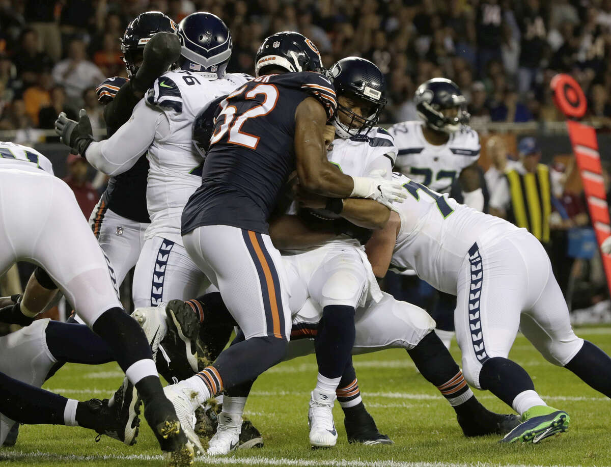 SEAHAWKS' O-LINE GETS BEAT UP AGAIN  After giving up six sacks to the Broncos last week, the big question heading into Monday was how Seattle's offensive line would be able to handle Khalil Mack, Roquan Smith and co. on the Bears' defensive front.  Essentially, the problems in Denver were again present in Chicago. The Bears also sacked Russell Wilson six times, five of which came in the first half.    Looking like an early Defensive Player of the Year candidate for the second consecutive week, Mack put the hurt on the Seahawks from both the left and right side. He recorded a sack and fumble to go along with five tackles.  But it wasn't just the Mack show. The Bears' six sacks were spread amongst five players. Linebacker Danny Trevathan led the way with two and had the game-clinching forced fumble in the fourth quarter.  Wilson has been sacked an NFL-high 12 times through two games.