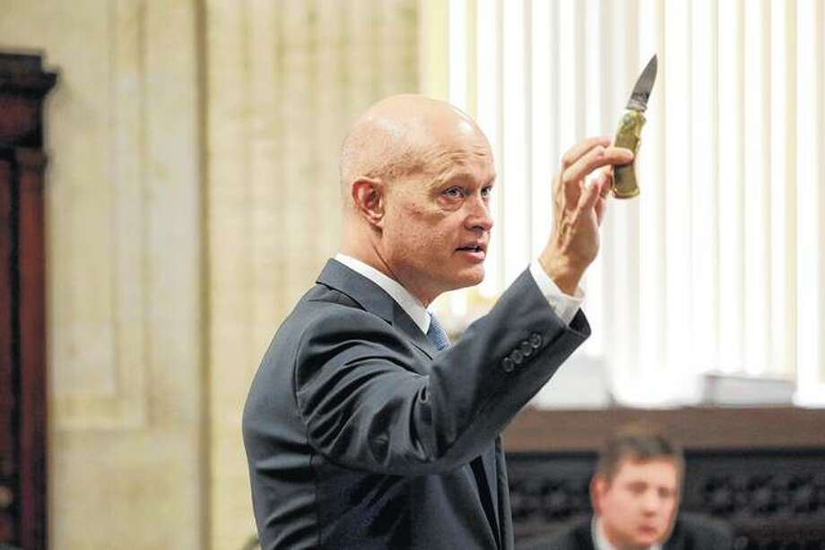 Special prosecutor Joseph McMahon holds the 3-inch blade Laquan McDonald carried Oct. 20, 2014 — the night we was killed — during opening statements Monday in the first-degree murder trial for Chicago police Officer Jason Van Dyke at Leighton Criminal Court Building in Chicago. Photo: Antonio Perez | Chicago Tribune Via AP, Pool